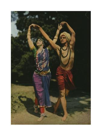 Two Modern Entertainers Perform an East Indian Dance