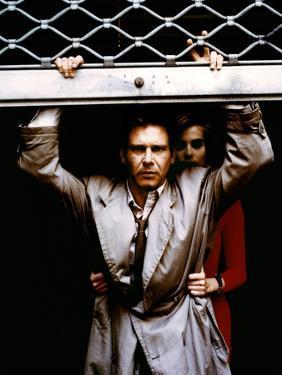 FRANTIC, 1988 directed by ROMAN POLANSKI Harrison Ford and Emmanuelle Seigner (photo)