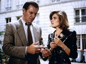 FRANTIC, 1988 directed by ROMAN POLANSKI Harrison Ford and Emmanuelle Seigner (photo)