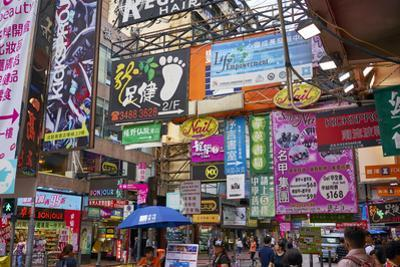 Advertising signs on a busy street in the popular shopping area of Mong Kok (Mongkok), Kowloon, Hon by Fraser Hall