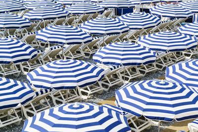 Blue and white beach parasols, Nice, Alpes Maritimes, Cote d'Azur, Provence, France, Mediterranean,
