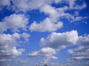 Blue Sky and Puffy White Clouds by Fraser Hall