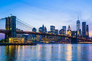 Brooklyn Bridge and Manhattan skyline at dusk, New York City, United States of America, North Ameri by Fraser Hall