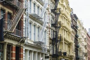 Old buildings and fire escapes in the Cast Iron District of SoHo, Manhattan, New York City, United  by Fraser Hall