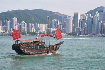 Traditional Chinese junk boat for tourists on Victoria Harbour, Hong Kong, China, Asia by Fraser Hall