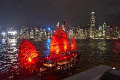 Traditional Chinese junk boat for tourists on Victoria Harbour illuminated at night, Hong Kong, Chi