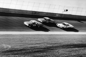 Three Stock Cars Racing on Track by Frederic Lewis