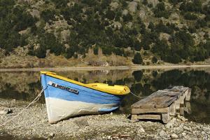Chile, Aysen, Bertrand, baker River. Fishing boat on the shore of Lago Bertrand. by Fredrik Norrsell