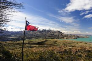 Chilean Flag on a Overlook, Puerto Ibanez, Aysen, Chile by Fredrik Norrsell