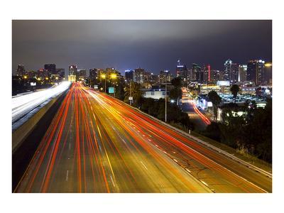 https://imgc.allpostersimages.com/img/posters/freeway-san-diego-skyline_u-L-F7PIS30.jpg?artPerspective=n