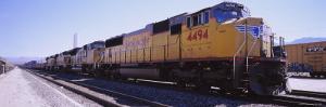 Freight Train on Railroad Tracks, California, USA