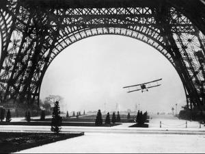French Aviator Lieutenant Collot Successfully Flies His Biplane Beneath the Tour Eiffel