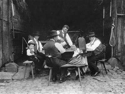 Alsatian Family Sitting at a Table in a Barn at Mietesheim, c.1900