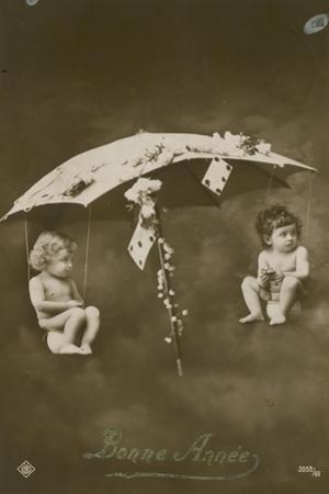 Happy New Year Card with Two Babies Hanging from an Umbrella, Sent in 1913 by French Photographer