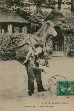 Postcard of a Man Carrying a Donkey, Sent in 1913 by French Photographer
