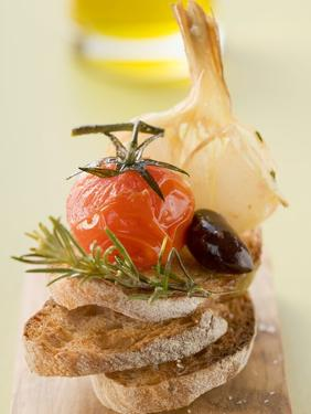 Fried Cherry Tomato, Olive and Garlic on Toast
