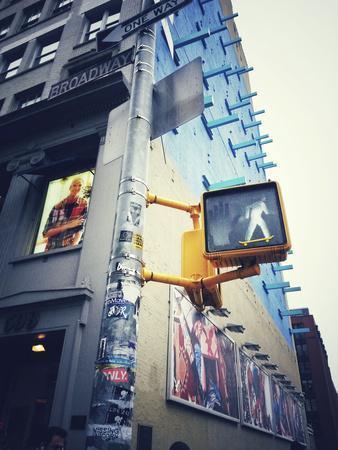 Traffic Light with Skateboard Sticker in New York City