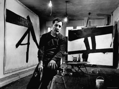 Abstract Expressionist Painter, Franz Kline, in Studio with His Black and White Paintings