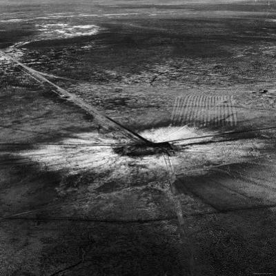 First Atomic Bomb's Dark Crater Surrounded by Glass Created by Heated Sand from Explosion