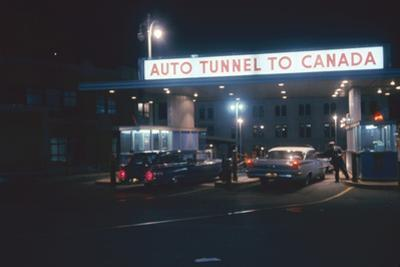 Nighttime View of the Cars at the Entrance to the Detroit-Windsor Tunnel, Detroit, Michigan, 1959
