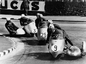 Fritz Scheidegger, Walter Schneider and Helmut Fath Competing in a Sidecar Race, 1959