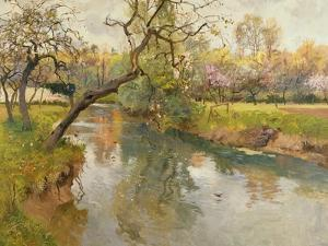 French River Landscape with a Flowering Tree by Fritz Thaulow