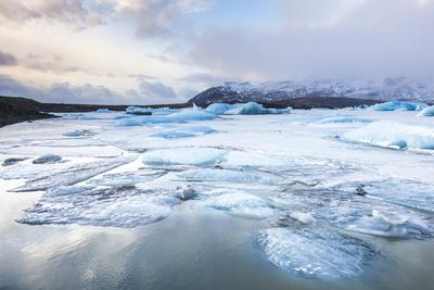 https://imgc.allpostersimages.com/img/posters/frozen-icebergs-in-the-frozen-waters-of-fjallsarlon-glacier-lagoon-south-east-iceland-iceland_u-L-PWFJTR0.jpg?p=0