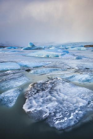 https://imgc.allpostersimages.com/img/posters/frozen-icebergs-in-the-frozen-waters-of-fjallsarlon-glacier-lagoon-south-east-iceland-iceland_u-L-PWFJWF0.jpg?p=0