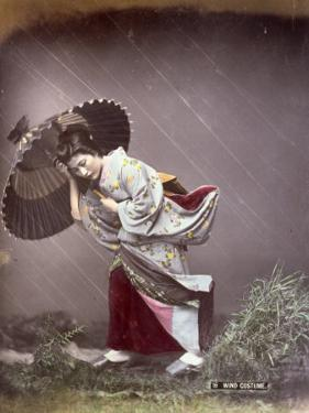 Full-Length Portrait in Studio of a Young Japanese Girl in a Traditional Costume Worn on Windy Days