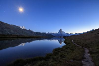 https://imgc.allpostersimages.com/img/posters/full-moon-and-matterhorn-illuminated-for-the-150th-anniversary-of-the-first-ascent-swiss-alps_u-L-Q12SAG00.jpg?p=0