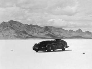 G.E.T. Eyston Breaking Speed Record in Automobile
