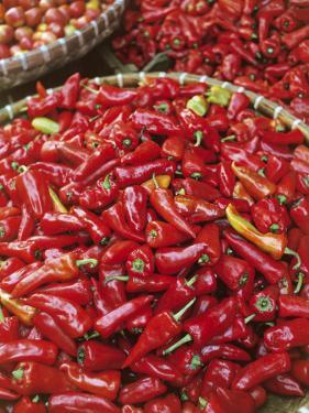 Red Chilli Peppers at a Market Stall by G. Wright