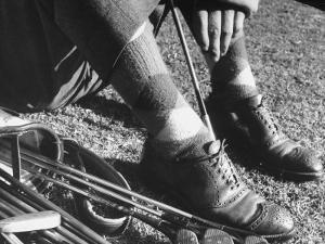 Feet and Golf Clubs Belonging to Golfer Byron Nelson by Gabriel Benzur