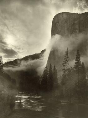 Mist Rises As El Capitan Towers 3,600 Feet Above the Merced River by Gabriel Moulin