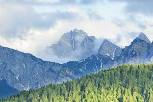 The Mount Sernio Emerges from the Clouds and Stands with Majesty Abiove the Green Woods, Alpi Carni by Gabriele Bano