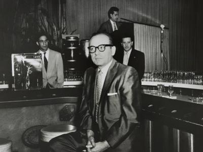 Gangster Santo Trafficante Sitting on a Stool in His Sans Souci Night Club in Havana, Cuba