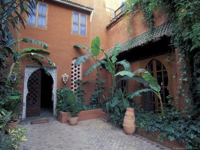 https://imgc.allpostersimages.com/img/posters/garden-courtyard-in-hotel-palais-salaam-morocco_u-L-P5865W0.jpg?p=0