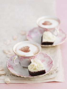 Petit Fours and Cappuccino Decorated with Cocoa Powder Hearts by Gareth Morgans
