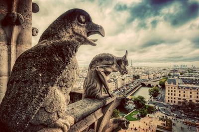https://imgc.allpostersimages.com/img/posters/gargoyles-and-chimera-statues-of-notre-dame-over-paris-france-skyline-dark-clouds-vintage_u-L-Q105QQB0.jpg?p=0