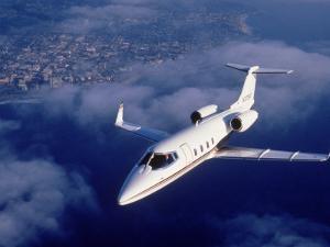 Lear Jet in Flight by Garry Adams