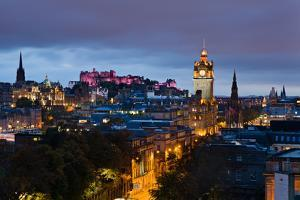 Edinburgh castle and the city buildings lit in twilight, Edinburgh, Lothian, Scotland, United Kingd by Garry Ridsdale
