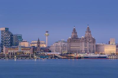 Looking across the River Mersey to the Liverpool skyline and Liver buildings at dusk, Liverpool, Me by Garry Ridsdale