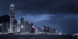 Looking across Victoria Harbour to Skyscrapers on Hong Kong Island with Victoria Peak Beyond by Garry Ridsdale
