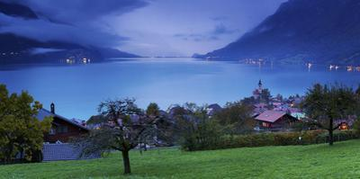 Looking over Chalets and Church of Brienz to Lake Brienz as Twilight Falls over Bernese Oberland by Garry Ridsdale