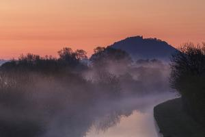 Mist Lingers Among Trees Along Shropshire Union Canal as it Snakes its Way Through Cheshire Plain by Garry Ridsdale