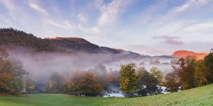 Panorama Overlooking Horseshoe Falls with Mist Lying Above the River Dee on an Autumn Morning by Garry Ridsdale