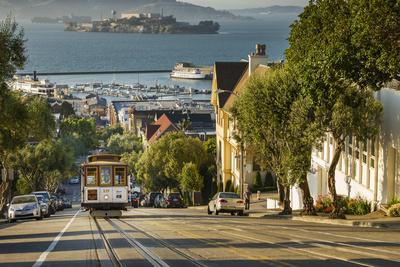 San Francisco City Tram Climbs Up Hyde Street with Alcatraz Beyond, San Francisco, California