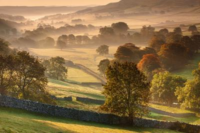 The Littondale Valley Lit by Early Morning Light on a Misty Autumn Morning in Yorkshire Dales by Garry Ridsdale