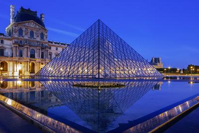 The Louvre Pyramid and Palace Reflected in a Still Pool Within the Napoleon Courtyard at Twilight