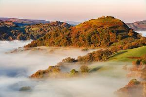 The Medieval Castle Dinas Bran Standing Above the Mist and Fog on an Autumn Morning, Denbighshire by Garry Ridsdale